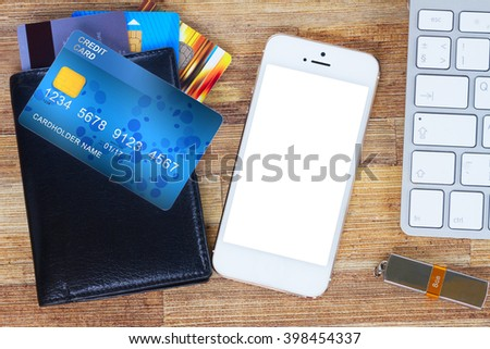desk with mobile  phone and wallet with plastic cards - stock photo