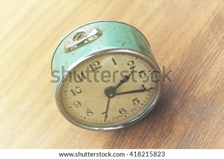Desktop home watch on a wooden background - stock photo
