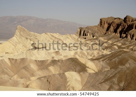Desolate, dry, jagged hills of Death Valley. - stock photo