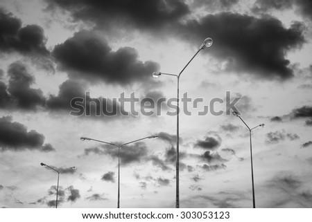 Desolate street light on cloudy sky - stock photo