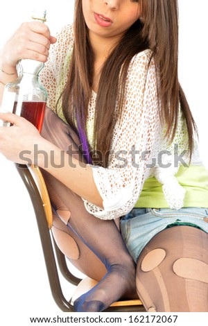 Despair and loneliness of an alcoholic woman - The loneliness of a desperate woman and alcoholic - stock photo