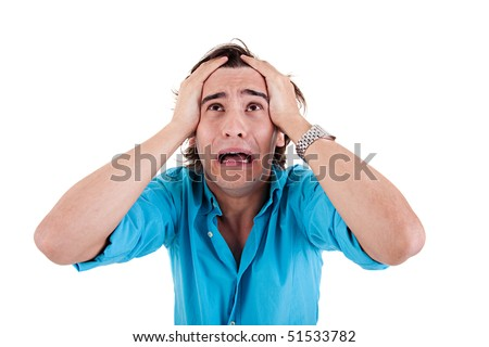 Despair of a young man, with hands on head, on white background. Studio shot - stock photo