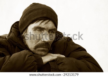 Despair of the homeless man. - stock photo