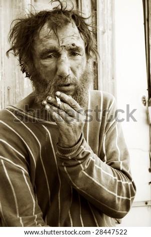 Despair of the poor homeless beggar. - stock photo