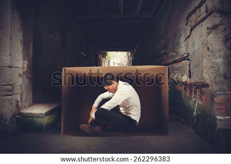 Desperate and fired businessman on the street - stock photo