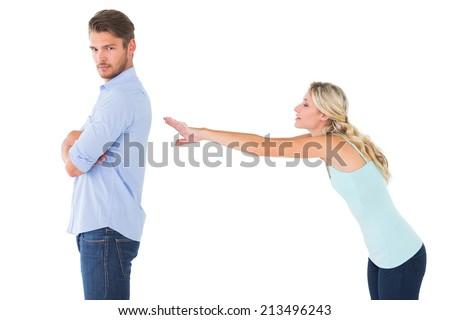 Desperate blonde reaching for boyfriend on white background - stock photo