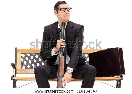 Desperate businessman ready to commit suicide isolated on white - stock photo