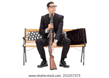 Desperate businessman ready to commit suicide isolated on white background - stock photo