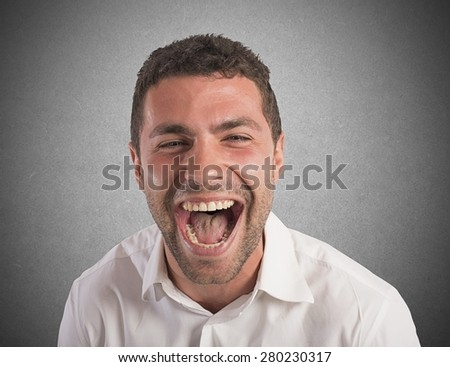 Desperate businessman stressed out from work screams - stock photo