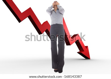 Desperate businesswoman against red arrow pointing down - stock photo