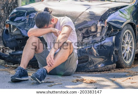 desperate man after car crash - stock photo