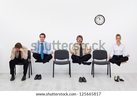 Desperate man having a handicap competing with the others showing special skills - stock photo