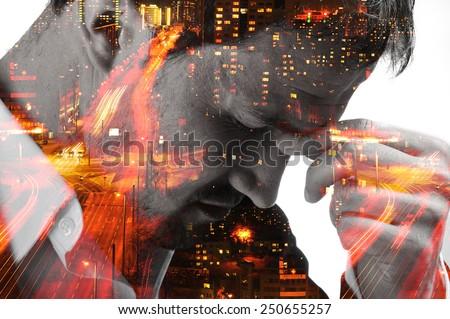 Desperate man on night city blurred lights - stock photo