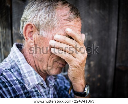 Desperate senior man suffering and covering face with hands in deep depression, pain, emotional disorder, grief and desperation concept - stock photo