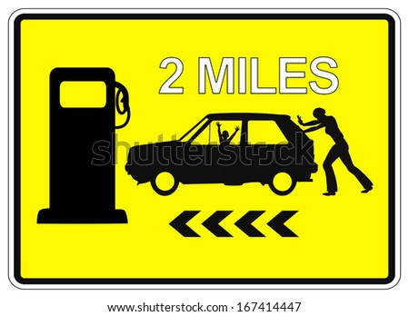 Desperate woman pushing car. Humorous Sign Post 2 Miles to the next Service Station for gas - stock photo