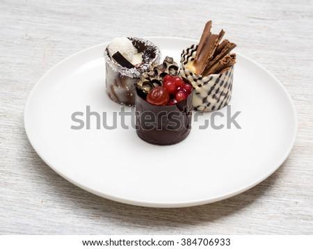 Dessert cakes on white plate - stock photo