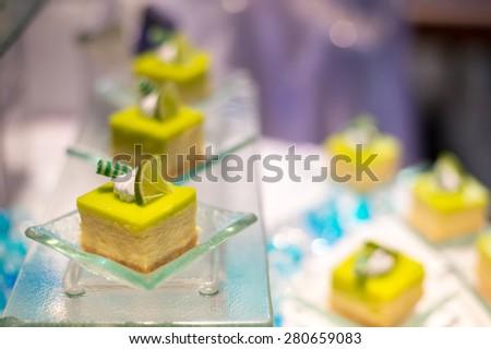 Dessert canape selection on slate platter - Lemon Cake - stock photo