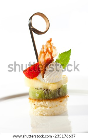 Dessert Canapes - Biscuit, Kiwi, Pineapple, Strawberry and Whipped Cream - stock photo
