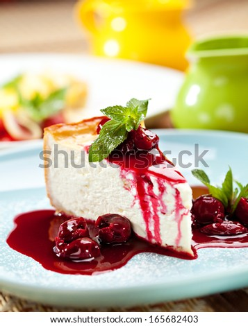Dessert - Cheesecake with Berries Sauce and Green Mint - stock photo