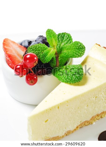 Dessert - Cheesecake with Fresh Berries Bowl and Green Mint - stock photo