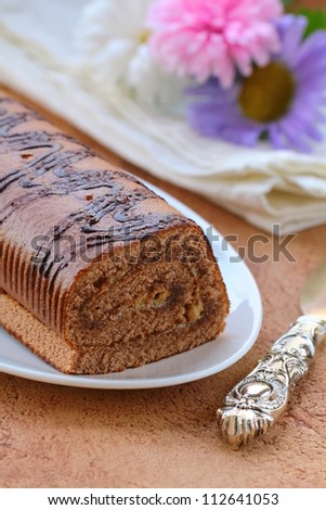 dessert chocolate biscuit roll on a plate - stock photo