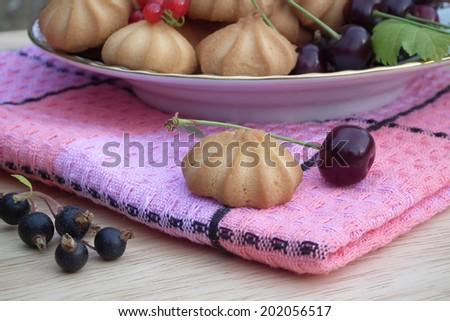 Dessert. Cookies with berries. - stock photo