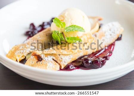 dessert crepe ice cream and blue berry jam - stock photo