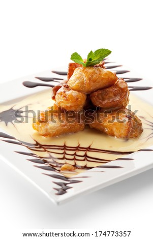 Dessert - Deep Fried Fruit Slice with Cream Sauce and Chocolate - stock photo