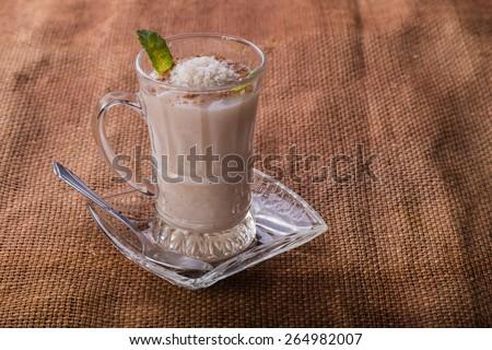 Dessert. Delicious dessert in a beautiful glass. Milk Arabic dessert. East dessert. - stock photo