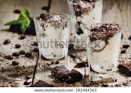 Dessert of dark chocolate, coffee and ice cream in small glasses, selective focus - stock photo