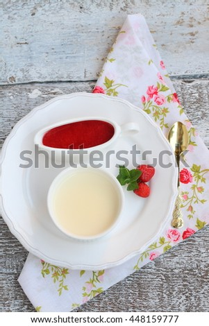 Dessert panna cotta in kremanke with strawberry sauce top view - stock photo