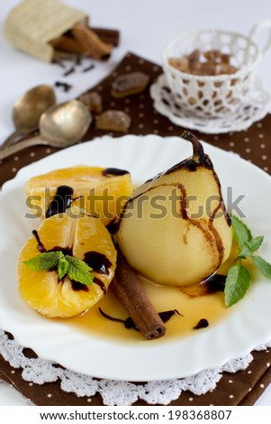 Dessert pears, cooked in wine - stock photo