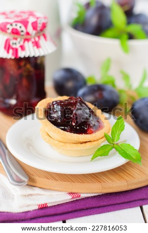 Dessert Plum, Orange and Mint Jam in Small Tart Shells (Tartlets), copy space for your text - stock photo