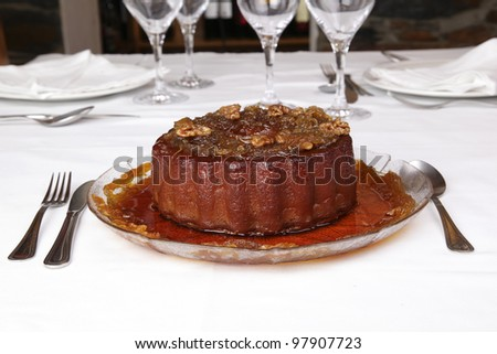 Dessert - Pumpkin pudding with nuts - stock photo