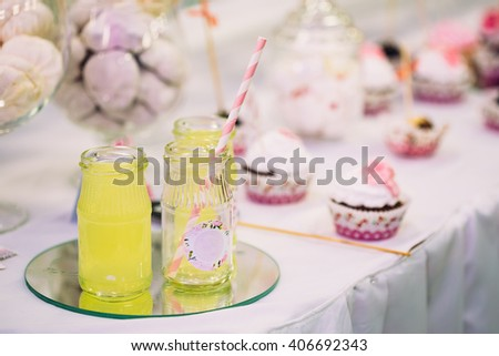 Dessert Sweet Tasty Cupcakes, Lemonade and Marshmallow In Candy Bar On Table. Delicious Sweet Buffet. Bright Wedding Decorations - stock photo