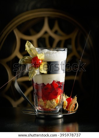 Dessert with creamy yogurt layered with pure and fresh berries in a glass - stock photo