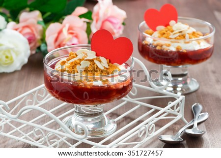 Dessert with jam and whipped cream for Valentine's Day, horizontal, close-up - stock photo