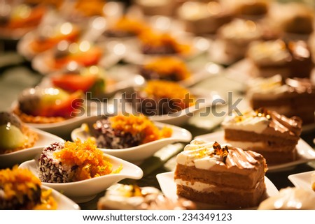 Desserts and Food  ;  Decorating desserts and food that was prepared for the wedding party. - stock photo