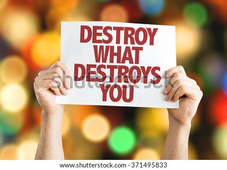 Destroy What Destroys You placard with bokeh background - stock photo