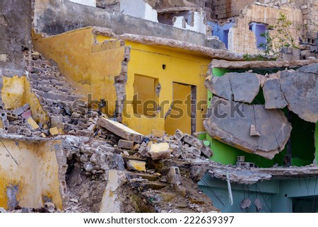 Destroyed and abandoned buildings and houses - stock photo