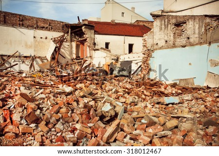 Destroyed brick buildings in the area of exposed reconstruction - stock photo
