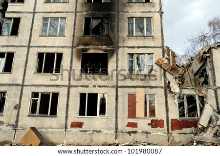 Destroyed building and pile of debris - stock photo