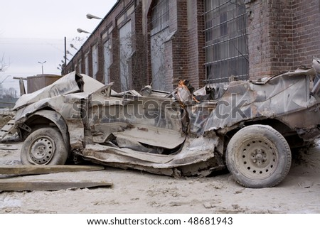 Destroyed car - stock photo
