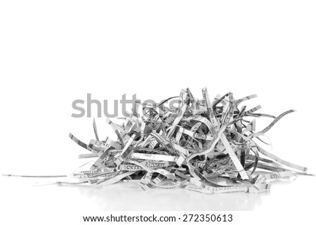Destroyed money from shredder isolated on white - stock photo