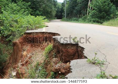 Destroyed road landslide damaged in powerful flood  - stock photo