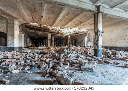 Destroyed room in an abandoned factory - stock photo