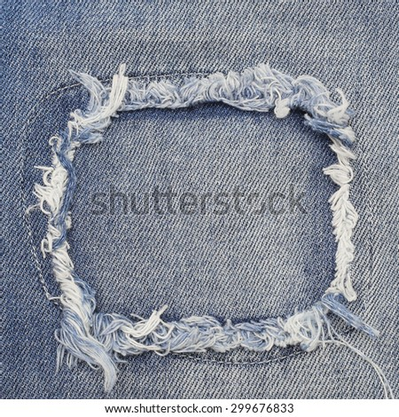 Destroyed torn denim blue jeans patch frame, close up  - stock photo
