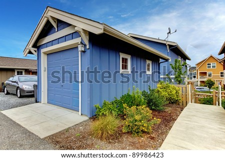 Detached garage of the blue house. - stock photo
