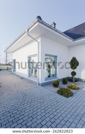 Detached house with white walls - view from the outside - stock photo