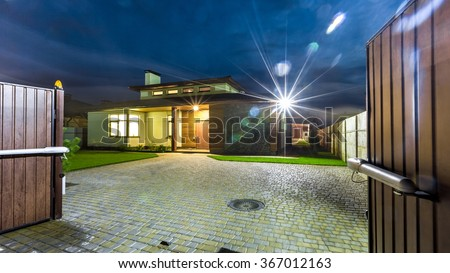 Detached luxury house at night - view from outside.  - stock photo
